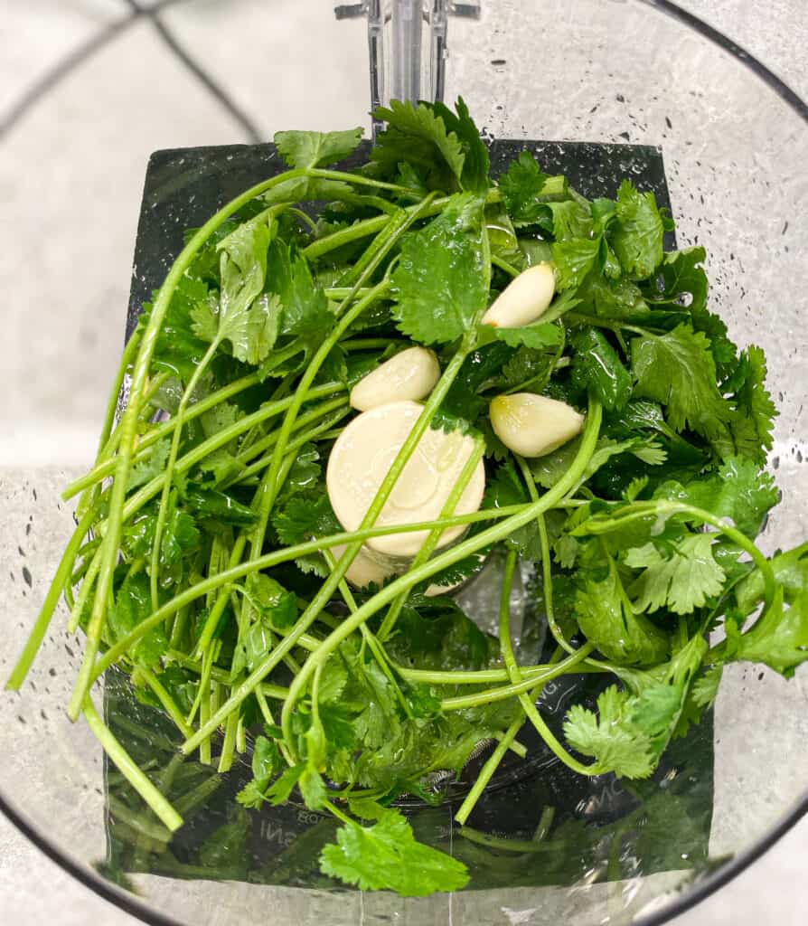 This is the cilantro, lime, garlic, and olive oil in the food processor.