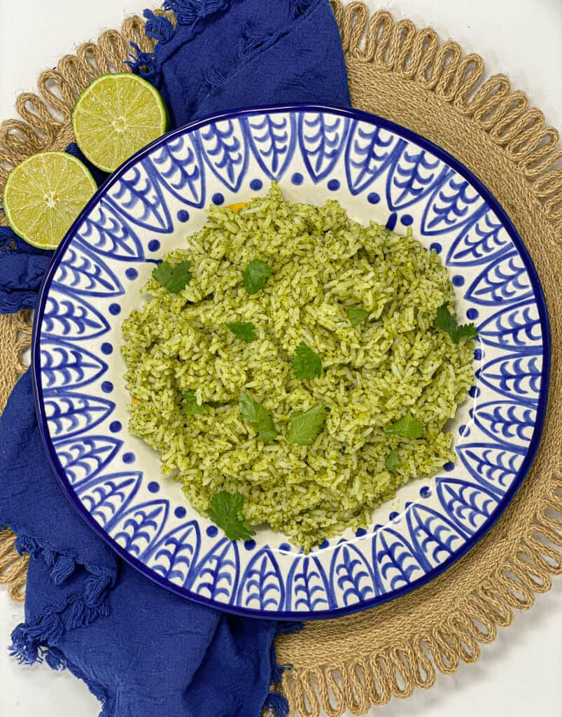 This is the best cilantro lime rice. It is super fluffy, and full of flavor. It packs a punch with a cilantro lime garlic pesto folded in.