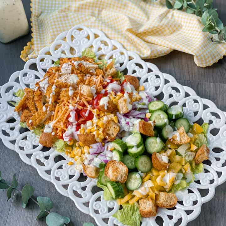 This is my Easy Crispy Chicken Tender Dinner Salad. It is loaded with veggies, chicken, croutons, and ranch.