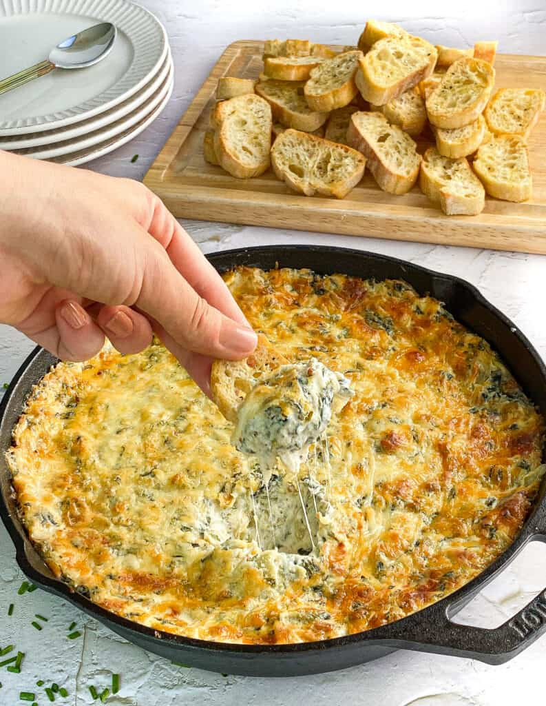 Dipping into the hot spinach & artichoke dip with a baguette