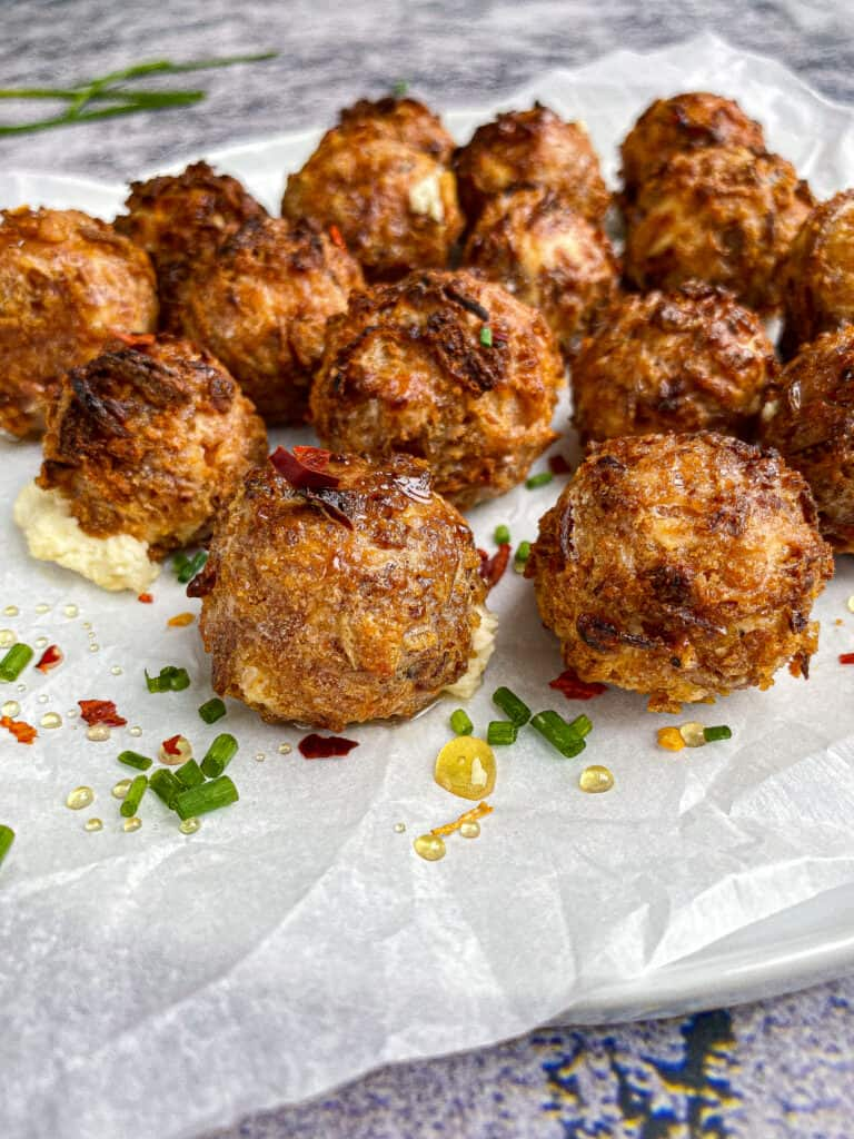 finished fried goat cheese ball topped with honey and chili