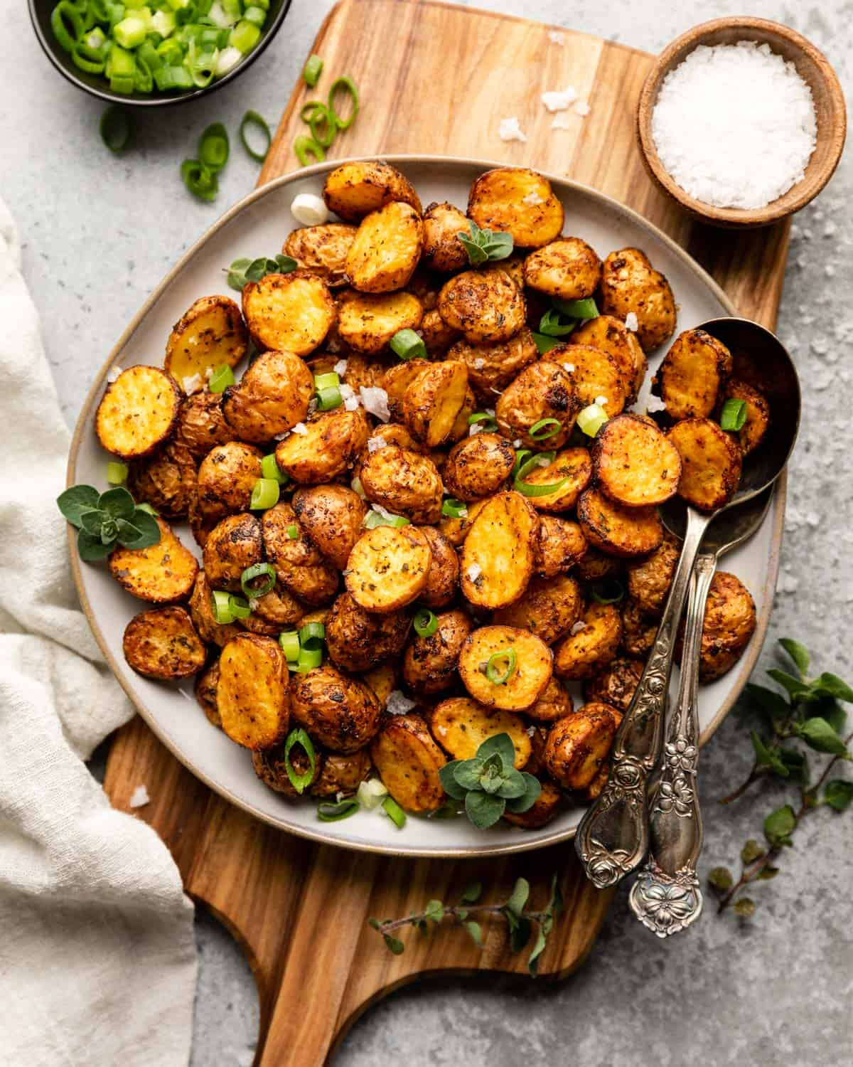 overhead of potatoes garnished with scallions and oregano