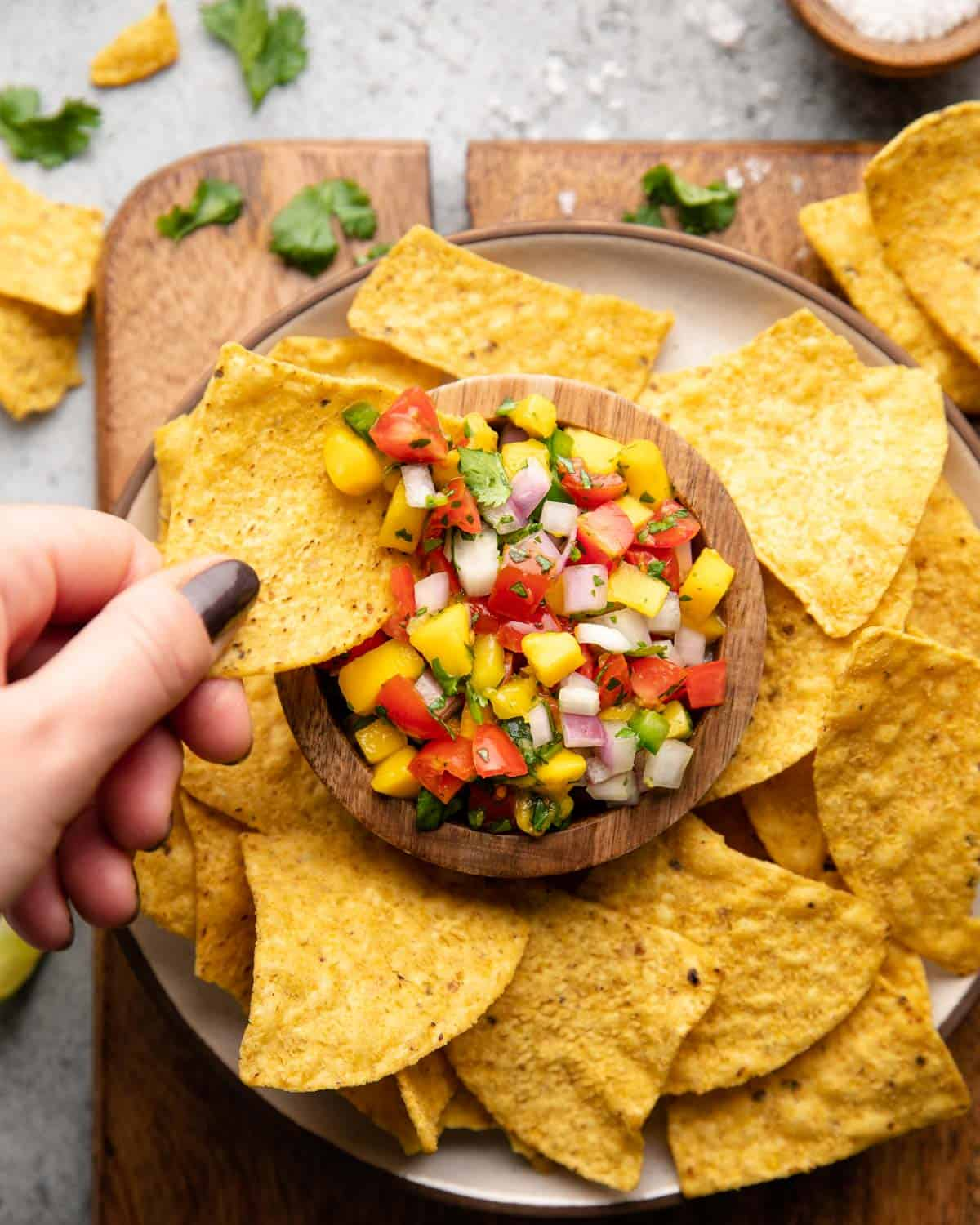 chip dipping in salsa
