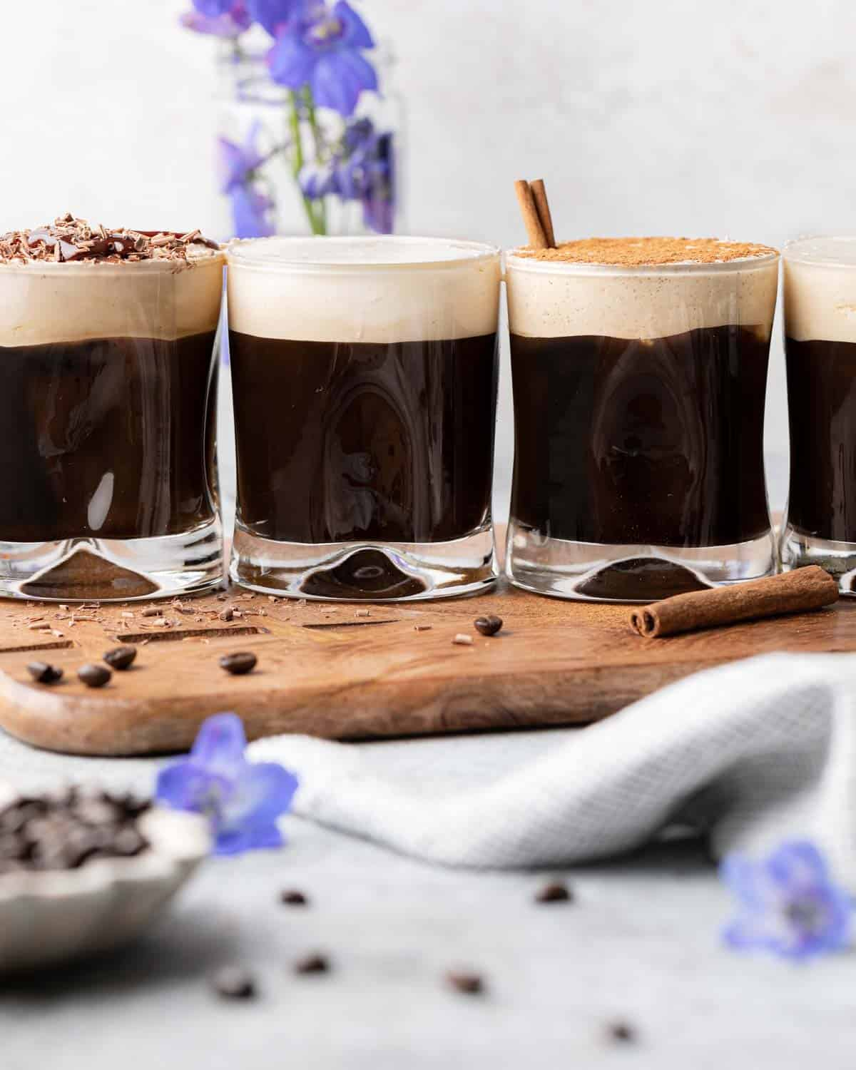 4 glasses of cold brew with cold foam on top