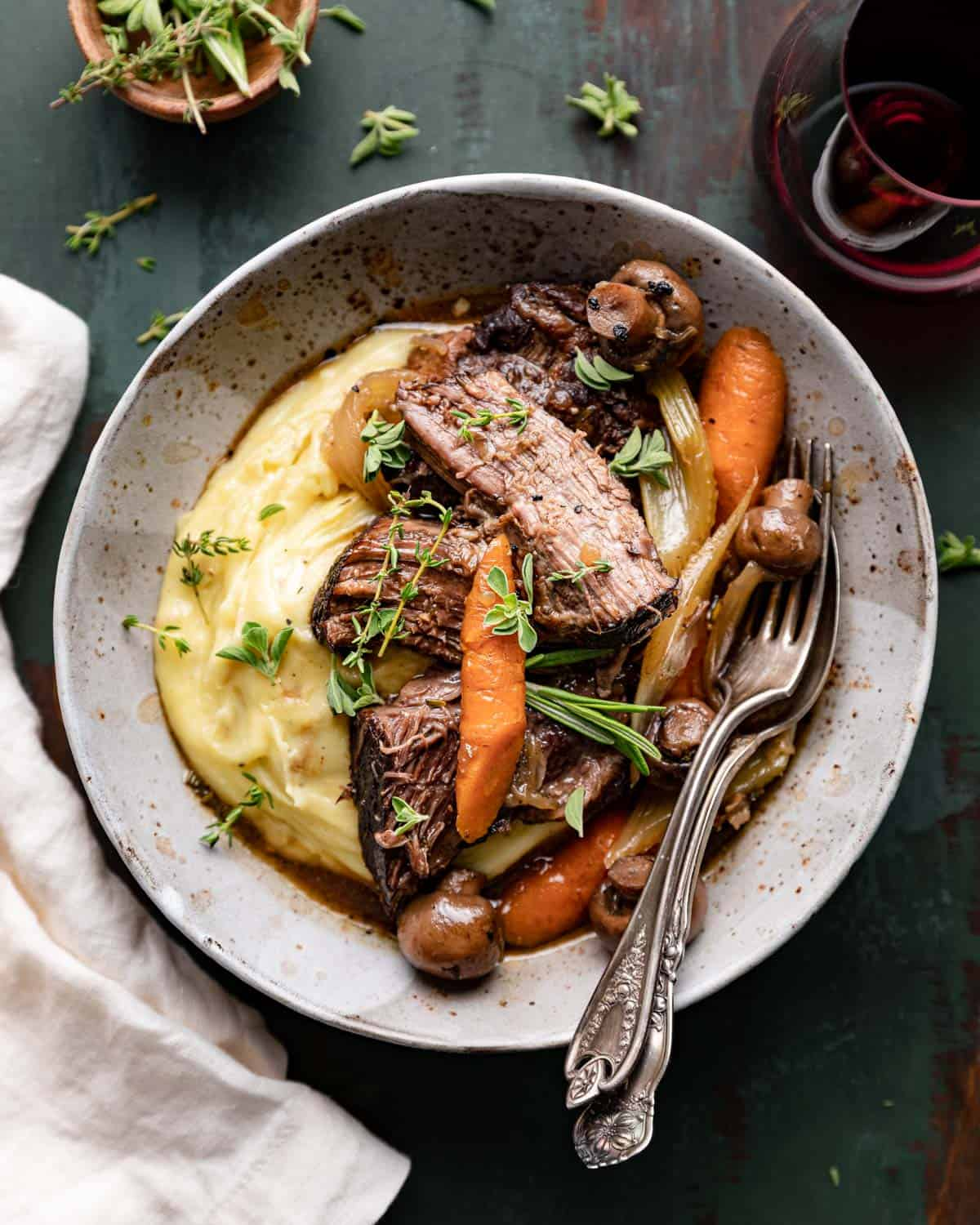 overhead of bowl with mashed potatoes, roast, and vegetables